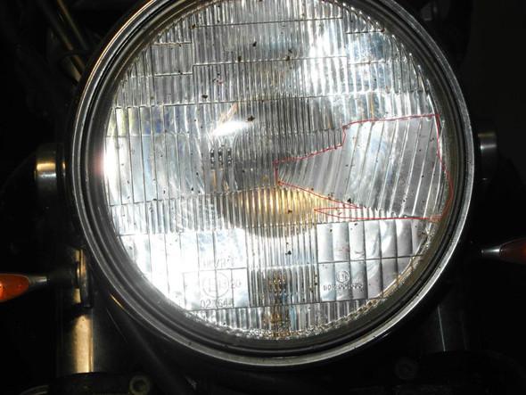asymmetrisch 10J. alt - (Scheinwerfer, England)